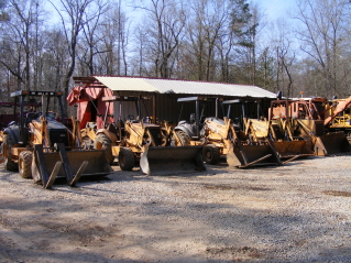 Two 580M, one 580L, one 580sk, and a 855 crawler loader.